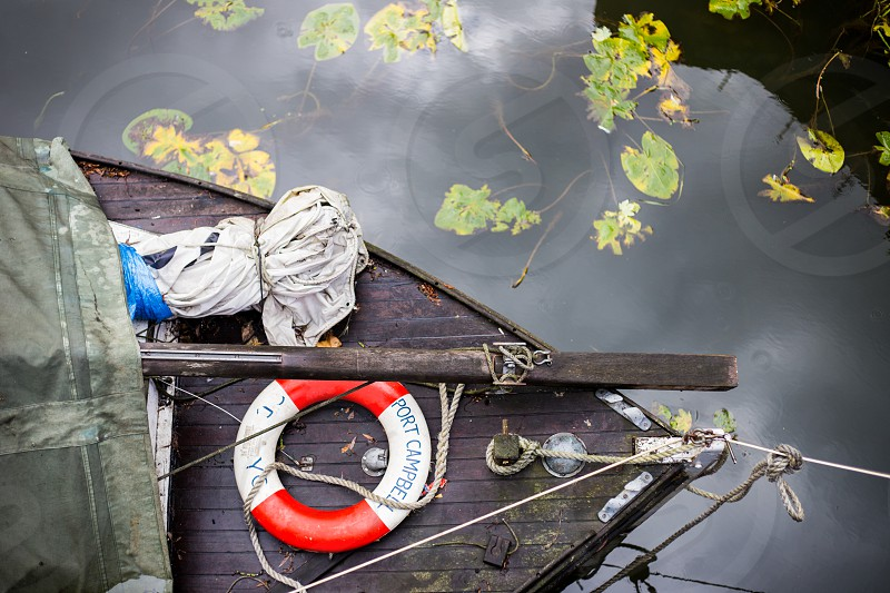 A small fisher's craft tied to the bank of a river near the center of Bath England. photo
