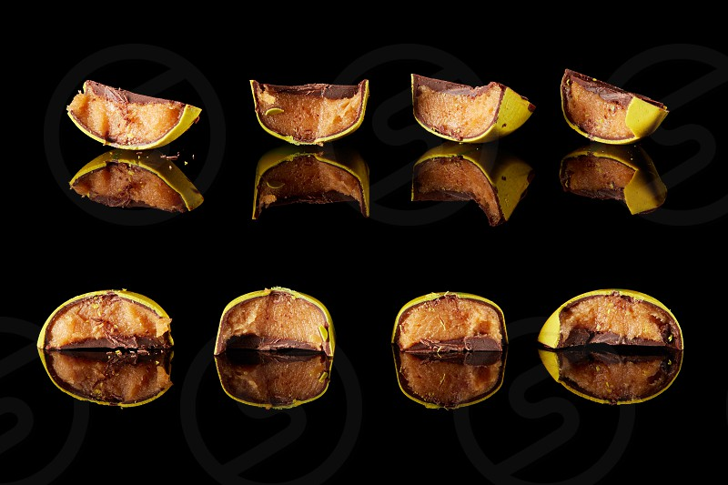 section of four home chocolate candy on a black background photo