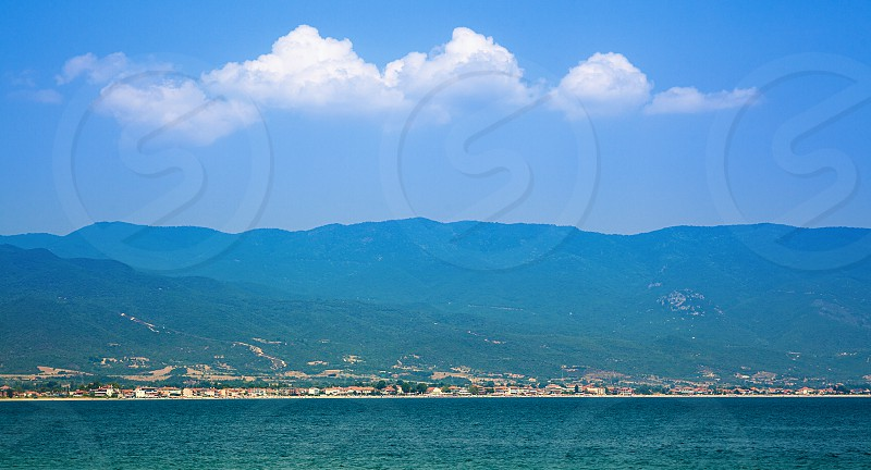 City of Stavros in Greece view from one of beaches during day.  photo
