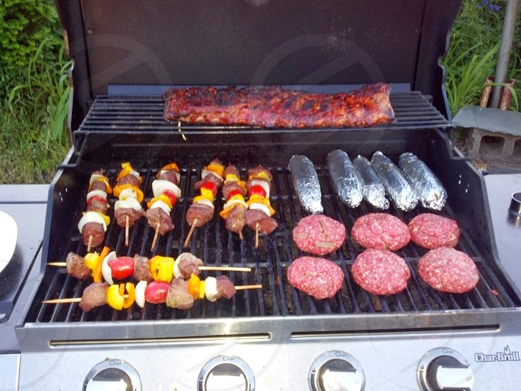 ribs burgers corn and kabobs photo