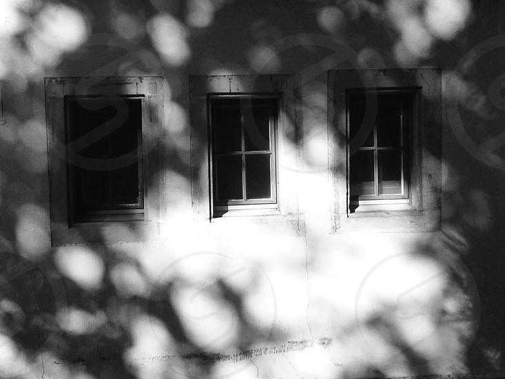 three windows of a house photo