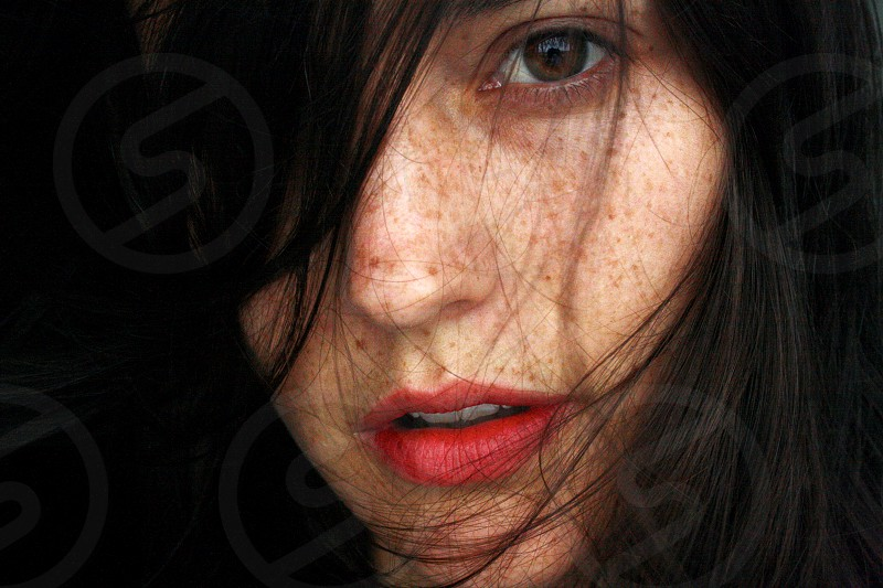woman's face with freckles photo