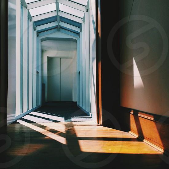 hallway leading to elevator doors photo