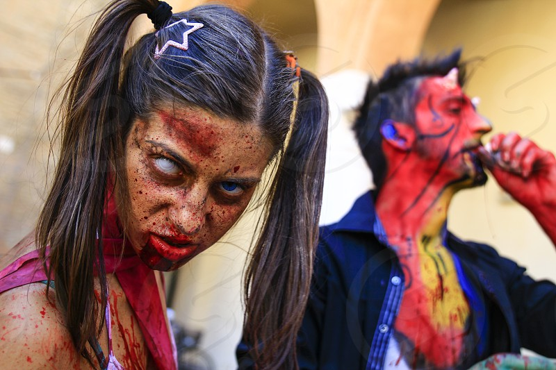 Ferrara Italy 16/09/2017: Funny cosplay dressed as Zombie and  devil photographed during a carnival photo