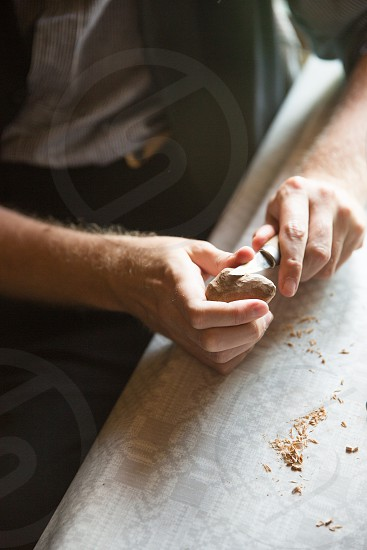 wood carving carpenter wood work carver knife hand crafts artisan hands handwork creativity carving making photo