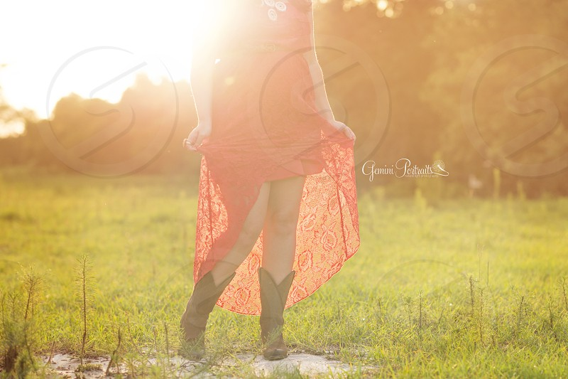 woman wearing red lace dress and black boots photo