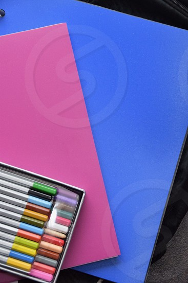 minimal notebooks and pencils lay flat  photo