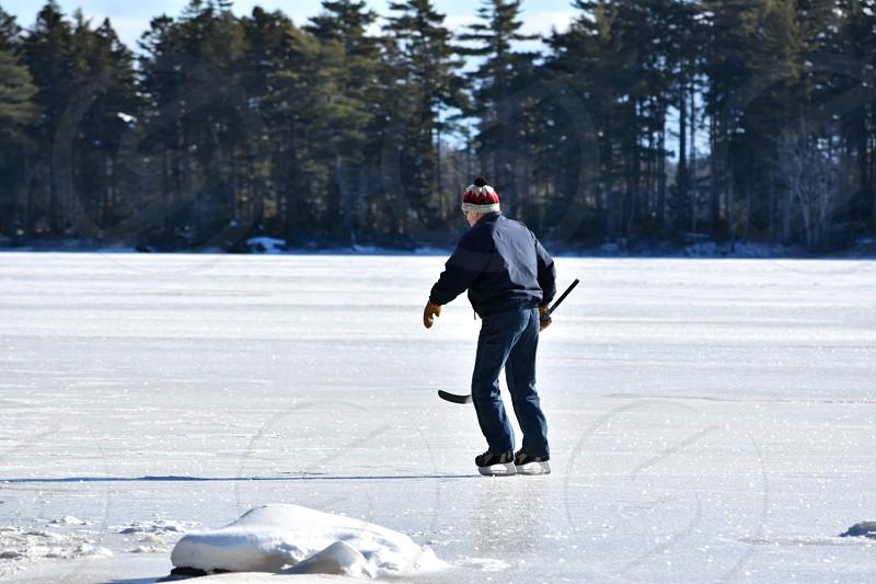 lake ice winter fitness heart pounding skates skating exercise hockey stick island photo
