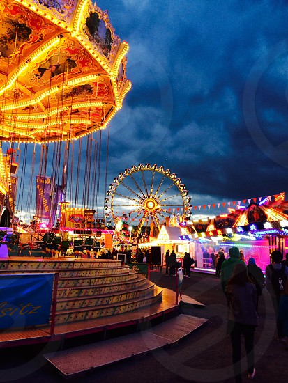 carousel and ferris wheel light photography photo