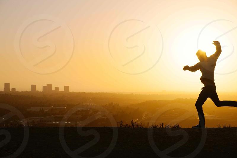 man playing slihouette photo