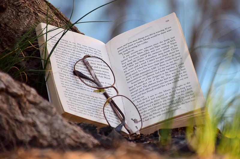 black frame eyeglasses behind a book photo