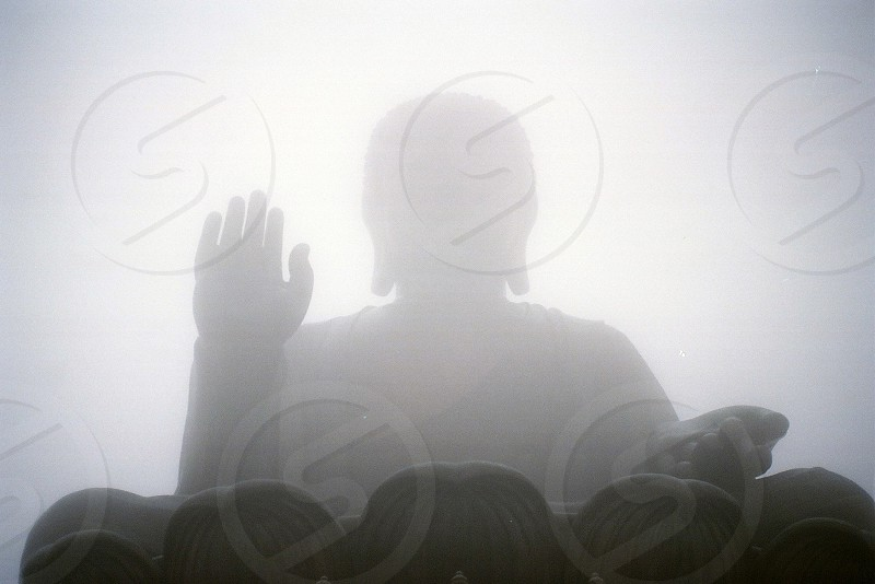 low angled photography of a buddha covered with fog photo