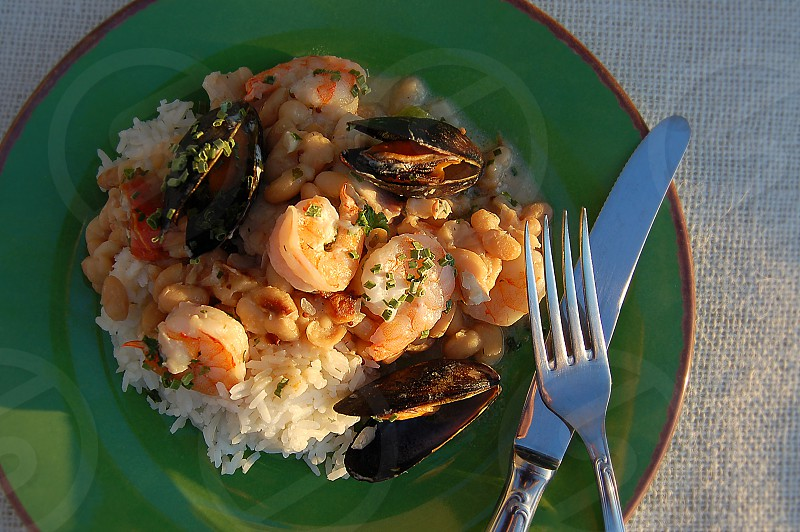 Shrimp and muscle paella over rice. photo
