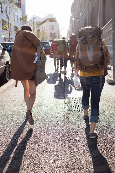 person carrying brown sports bag photo