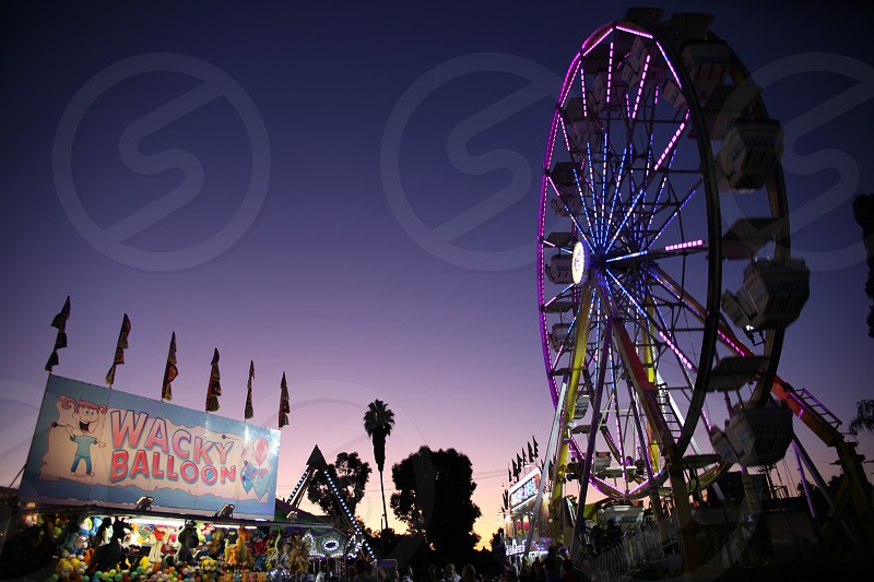 Carnival with purple sunset. photo