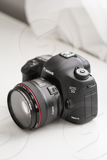 DSLR camera against a neutral background in natural light. photo
