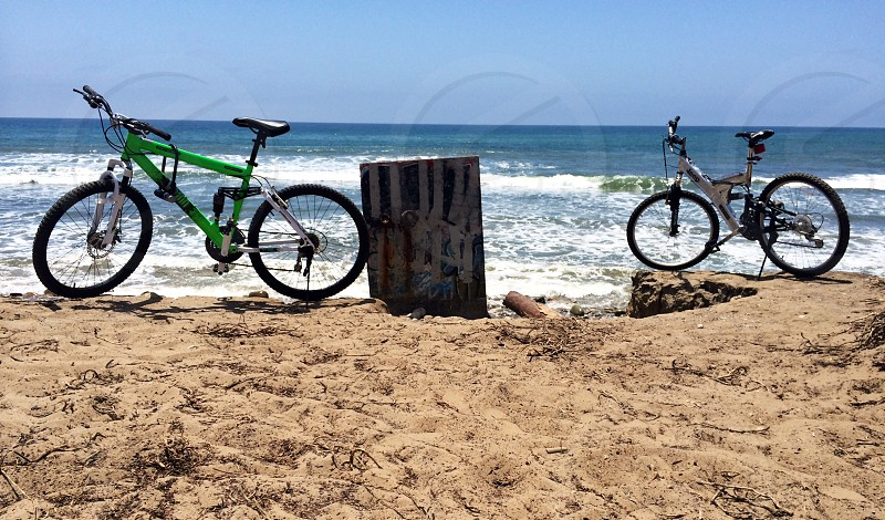 2 bicycles on the shore photo