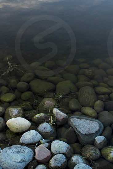 Pond rocks water mountain relaxing wildlife colorful hero image  photo