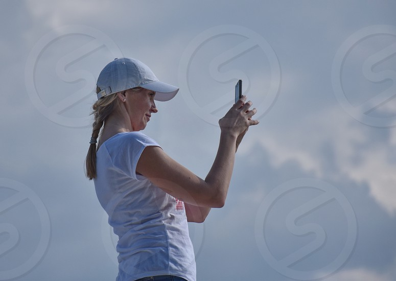 Young woman using mobile phone photo