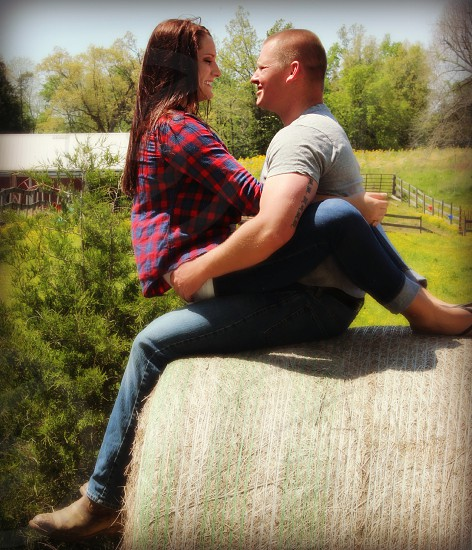 man and woman on hay bale photo