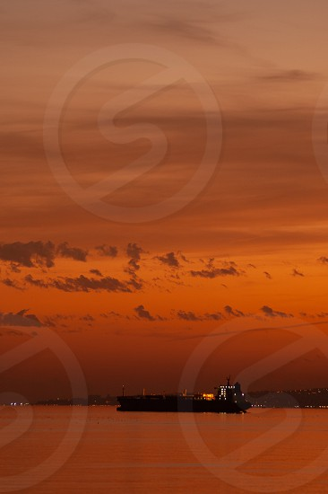 Cargo container ship at mediterranean coast in sunset Spain Malaga. photo