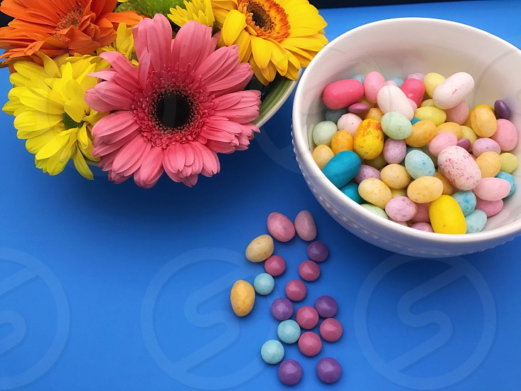 Easter colors with a snack! Easter holiday candy flowers. photo