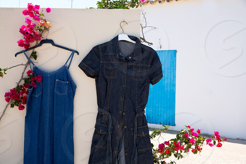 Mediterranean outdoor street second hand market with blue jeans in white wall photo