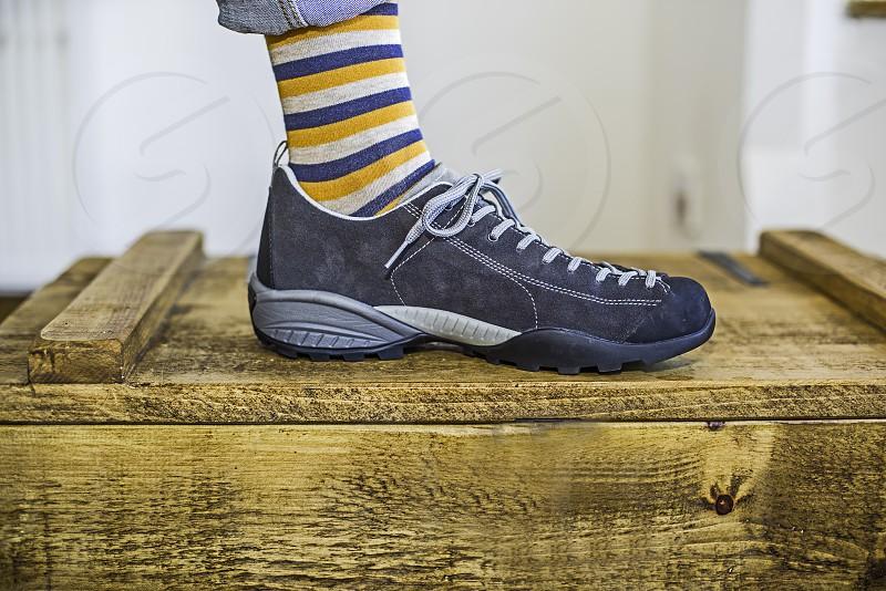 Stripy sock in a shoe on a box.. photo