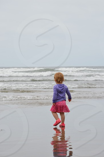 Innocence girl beach ocean refelection photo