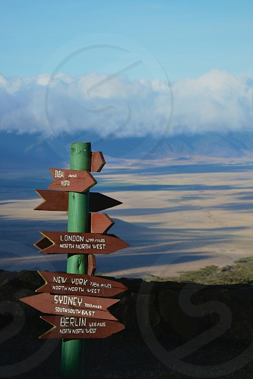 Signage points direction and distance to famous cities from the Ngorongoro Crater of Tanzania. photo