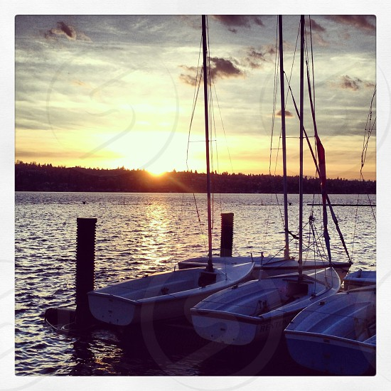 three boats on body of water photo