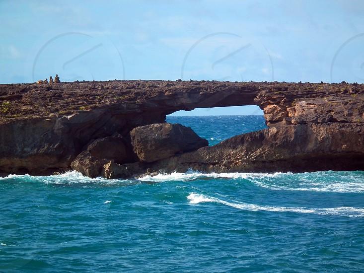 brown rock on sea photo