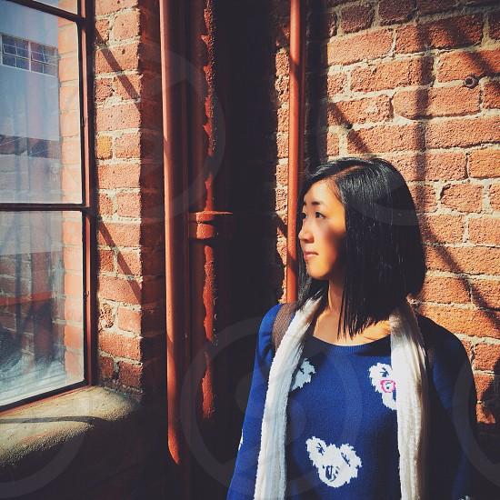 woman facing the window photography photo