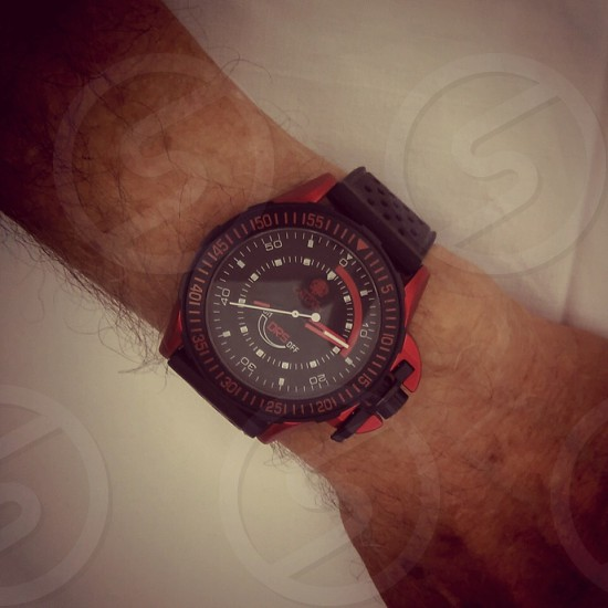 black strap black and red analog watch photo