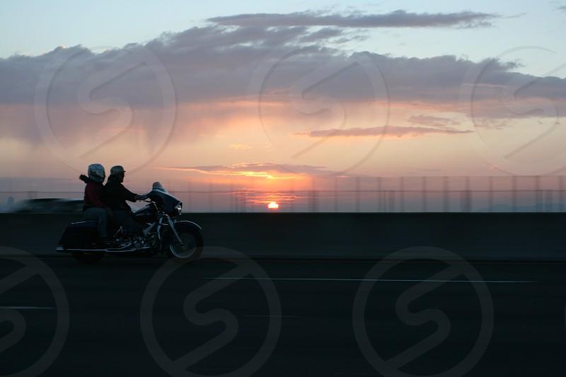 Motorcycle riding at sunset. photo