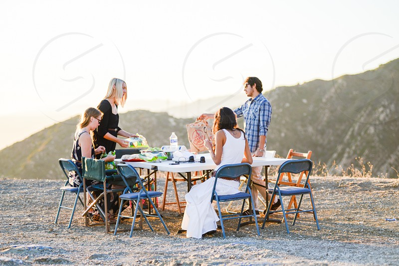 Sunset dinner party with friends photo
