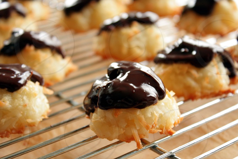 coconut macaroons macaroons with chocolate ganache maracoon cookies cookies on rack chocolate frosting photo