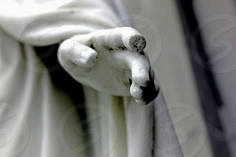 selective focus photography of person statue hand photo