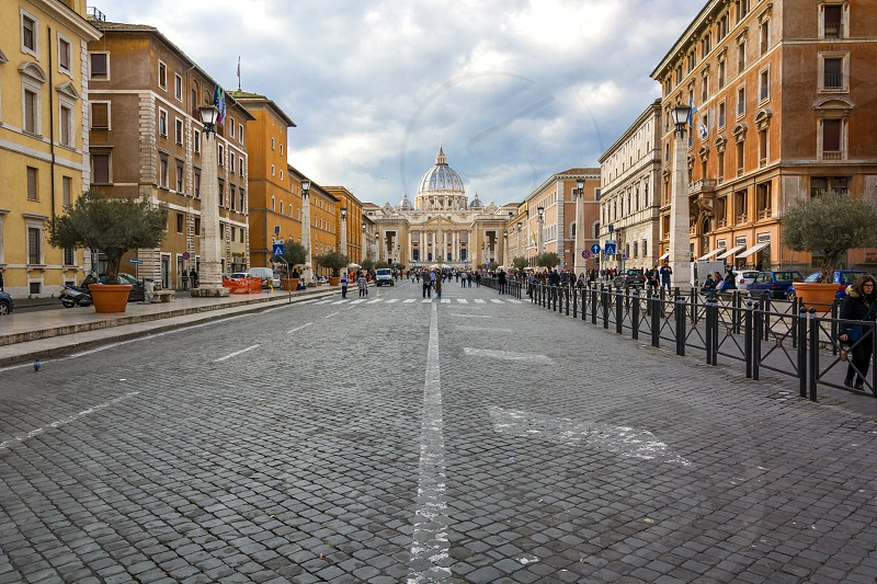 Via della Conciliazione with tourists and pilgrims with St. Peters in the distance. Via della Conciliazione connects Saint Peter's Square to the Castel Sant'Angelo on the western bank of the Tiber River. The road was constructed between 1936 and 1950 and it is the primary access route to the Square  photo