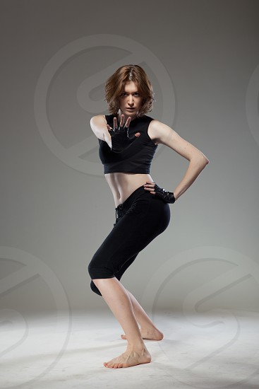 attractive young woman dancing photo