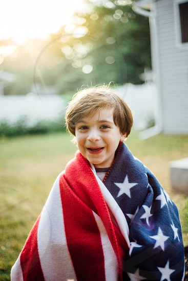 Little boy American flag 4th of July  photo