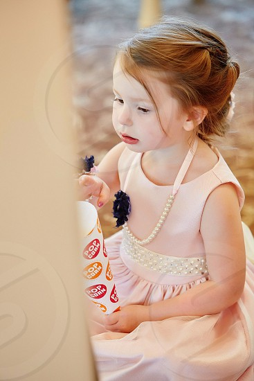 Flower girl wedding day bridal suite getting ready sweet girl pretty in pink pink and pearls the day sweet  photo