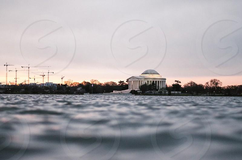 The sun rises over the Tidal Basin Washington D.C. photo