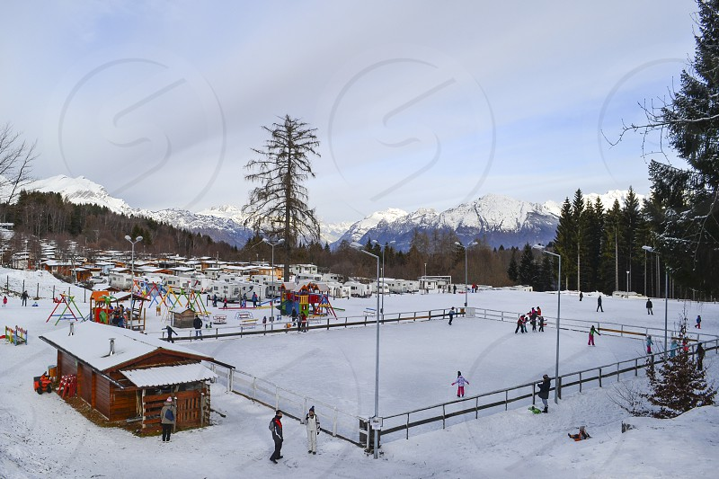 Public outdoor ice skating rink in Nevegal Italy. photo