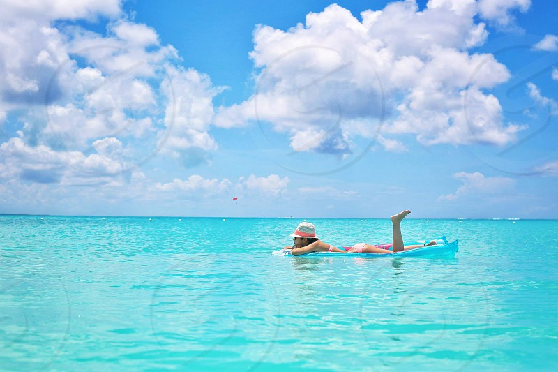 Infinity Pool. Relaxing. Vacation. Day dreaming. Ocean. Beach. Floating. photo