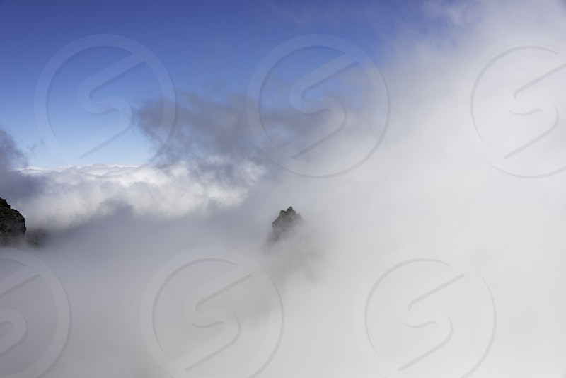 the high mountains at madeira island called pico arieiro coming out of the clouds the top is 1818 meters above sea level photo