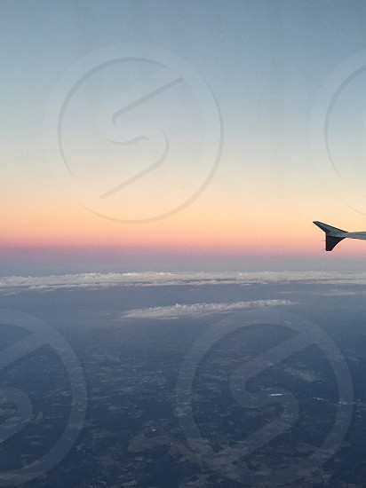 Flying airplane travel flight sky cabin view sunset wing photo