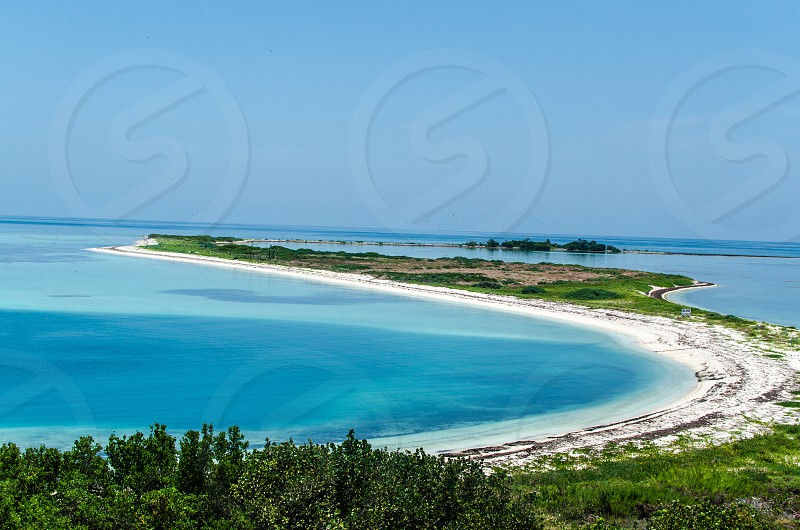 Picture of the ocean and beach at Dry Tortugas National Park located 70 miles off the coast of Key West. photo