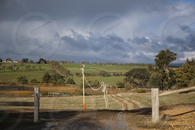 Farm and hills in regional Victoria photographed in the afternoon light photo