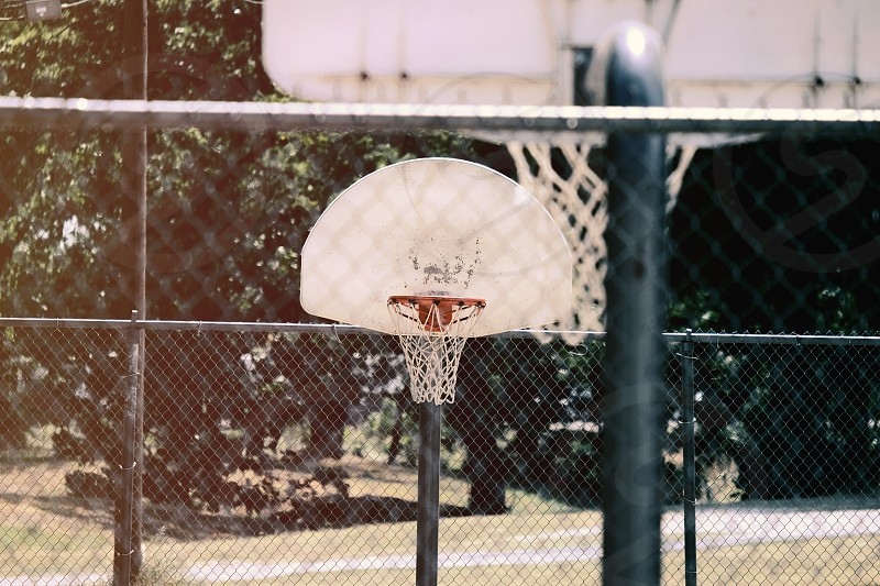 Outdoor basketball court hoops during summer. photo